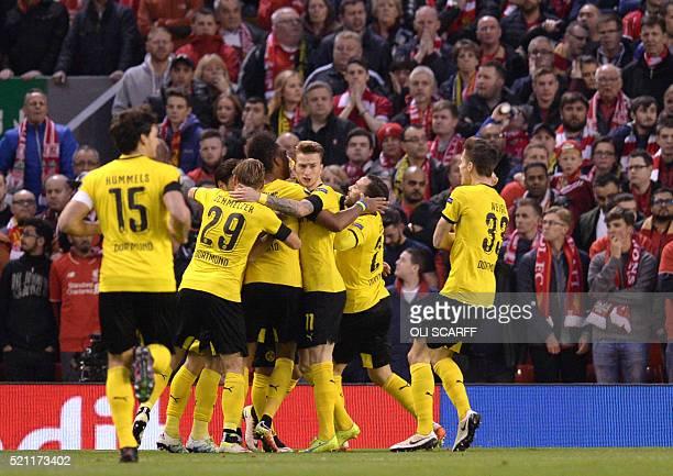 Dortmund's Armenian midfielder Henrikh Mkhitaryan celebrates with teammates after scoring during the UEFA Europa league quarterfinal second leg...