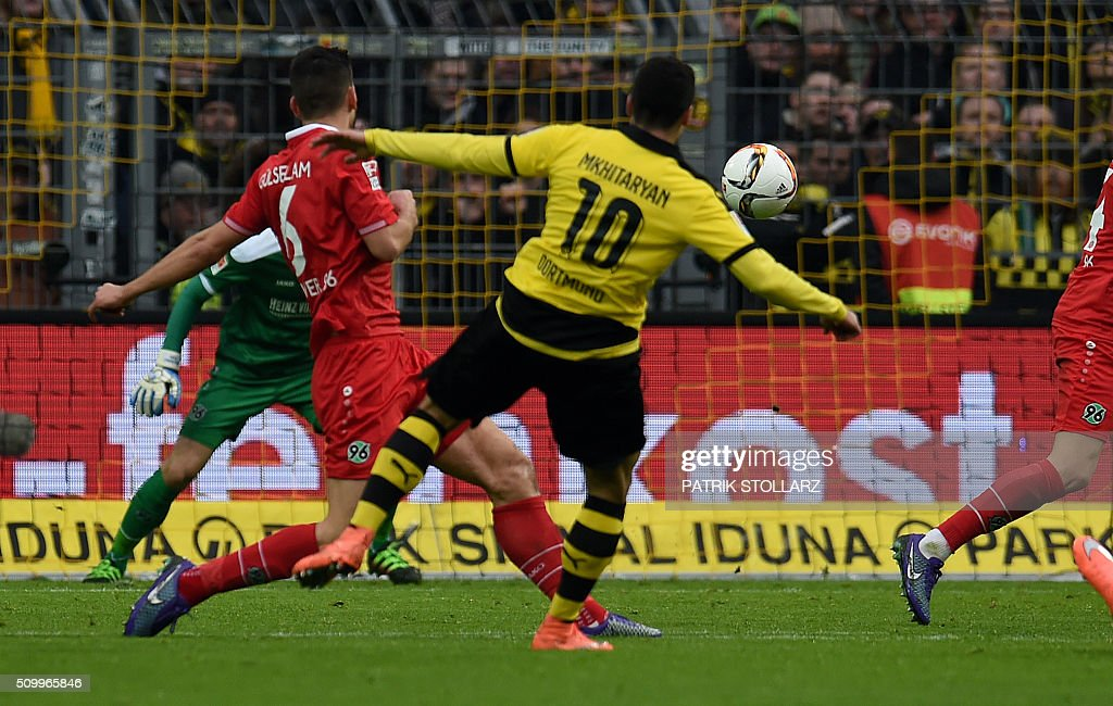 Dortmund's Armenian midfielder Henrikh Mkhitaryan scores for 1-0 goal during the German first division Bundesliga football match of Borussia Dortmund vs Hannover 96 in Dortmund, western Germany, on February 13, 2016. / AFP / PATRIK STOLLARZ /