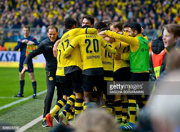 Dortmunds Aubameyang Dortmund's Gabonese striker PierreEmerick Aubameyang celebrates scoring the 50 goal with his teammates and coach Thomas Tuchel...