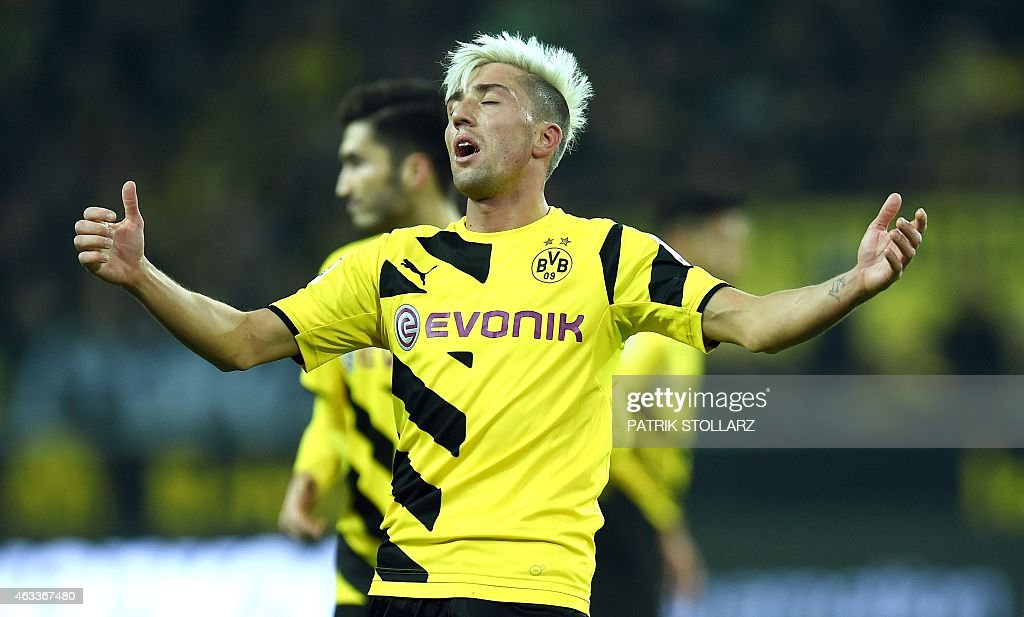 Dortmund's Austrian midfielder <a gi-track='captionPersonalityLinkClicked' href=/galleries/search?phrase=Kevin+Kampl&family=editorial&specificpeople=6527116 ng-click='$event.stopPropagation()'>Kevin Kampl</a> reacts during the German first division Bundesliga football match Borussia Dortmund v 1 FSV Mainz 05 in Dortmund, Germany, on February 13, 2015. AFP PHOTO / PATRIK STOLLARZ DFL RULES TO LIMIT THE ONLINE USAGE DURING MATCH TIME TO 15 PICTURES PER MATCH. IMAGE SEQUENCES TO SIMULATE VIDEO IS NOT ALLOWED AT ANY TIME. FOR FURTHER QUERIES PLEASE CONTACT DFL DIRECTLY AT + 49 69 650050.