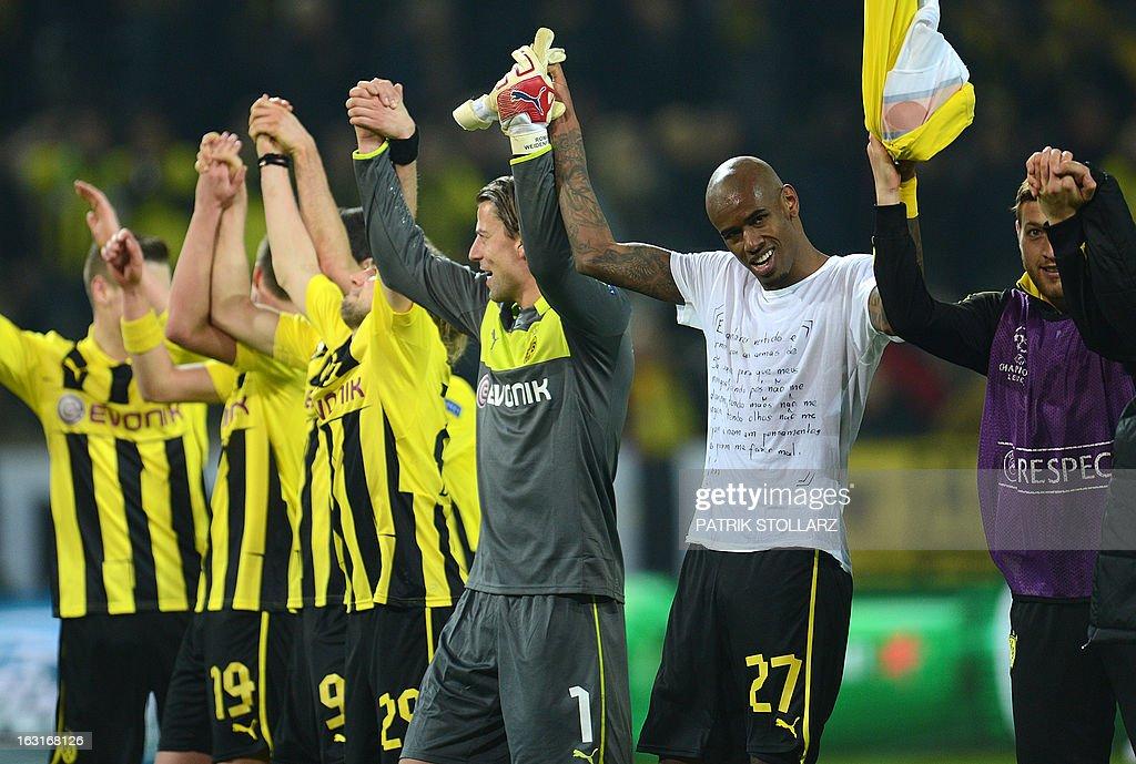 Dortmund's Brazilian defender Felipe Santana (2ndR) reacts with teammates at the end of the the UEFA Champions League last 16, second leg match Borussia Dortmund vs Shakhtar Donetsk in Dortmund, western Germany, on March 5, 2013.