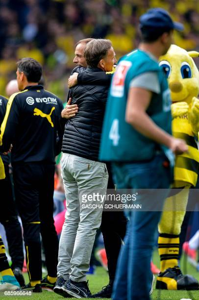Dortmund's CEO HansJoachim Watzke and Dortmund's head coach Thomas Tuchel hug after the German first division football match between Borussia...
