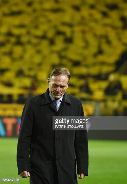Dortmund's CEO HansJoachim Watzke walks over the pitch prior to the Champions League football match between Borussia Dortmund and Benfica on March 8...