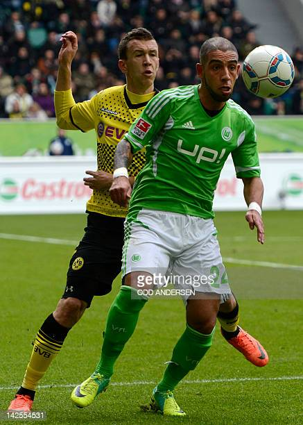 Dortmund's Croatian midfielder Ivan Perisic and Wolfsburg's Iranian midfielder Ashkan Dejagah vie for the ball during the German first division...