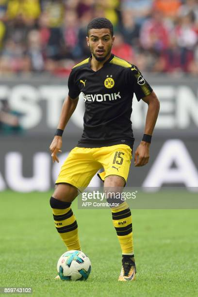 Dortmund's defender Jeremy Toljan runs with the ball during the German first division Bundesliga football match between FC Augsburg and Borussia...
