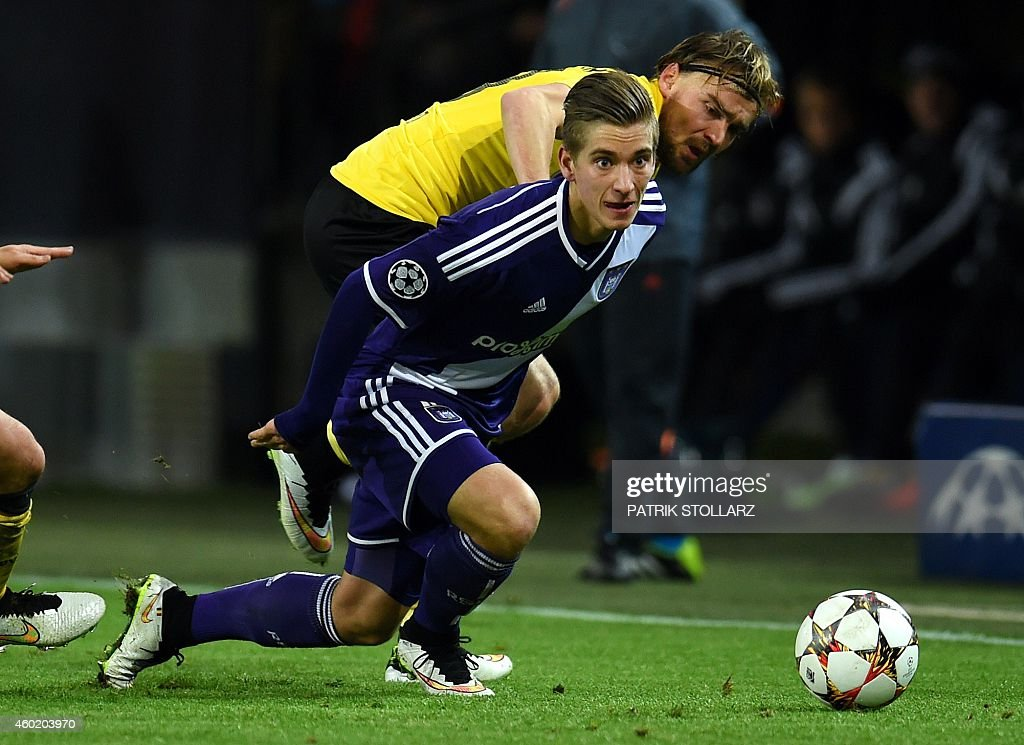 Dortmund's defender <a gi-track='captionPersonalityLinkClicked' href=/galleries/search?phrase=Marcel+Schmelzer&family=editorial&specificpeople=5443925 ng-click='$event.stopPropagation()'>Marcel Schmelzer</a> and Anderlecht's midfielder <a gi-track='captionPersonalityLinkClicked' href=/galleries/search?phrase=Dennis+Praet&family=editorial&specificpeople=8569027 ng-click='$event.stopPropagation()'>Dennis Praet</a> (front) vie for the ball during the second leg UEFA Champions League Group D football match BVB Borussia Dortmund vs Anderlecht in Dortmund, western Germany on December 9, 2014.