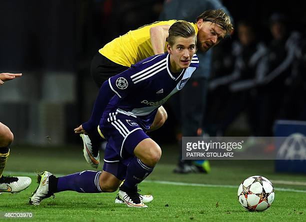 Dortmund's defender Marcel Schmelzer and Anderlecht's midfielder Dennis Praet vie for the ball during the second leg UEFA Champions League Group D...