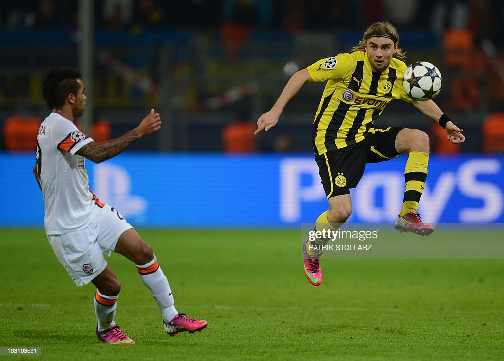 Dortmund's defender Marcel Schmelzer (R) controls the ball during the UEFA Champions League last 16, second leg match Borussia Dortmund vs Shakhtar Donetsk in Dortmund, western Germany, on March 5, 2013.