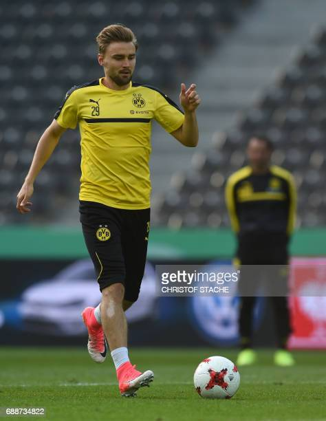 Dortmund's defender Marcel Schmelzer plays the ball during a training session on the eve of the German Cup football final match between Eintracht...
