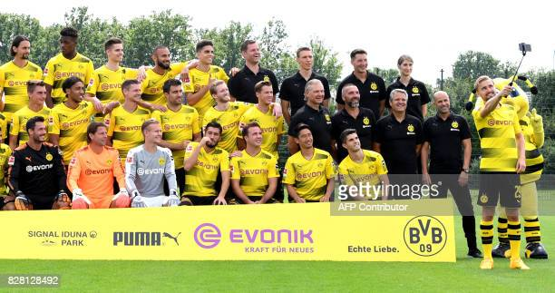 Dortmund's defender Marcel Schmelzer shoots a selfie during the team presentation of of German first division Bundesliga football club Borussia...
