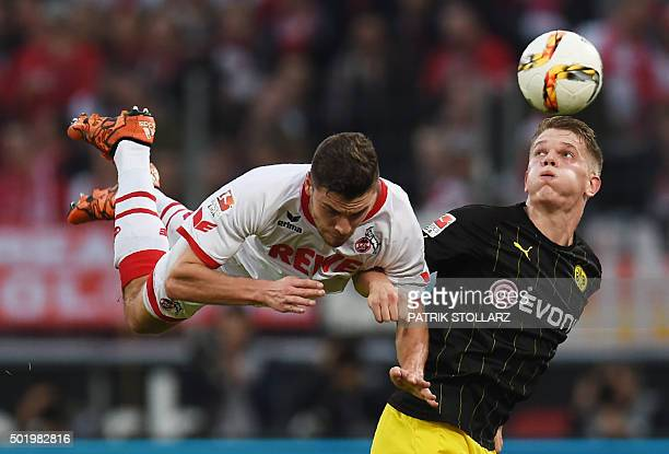 TOPSHOT Dortmund's defender Matthias Ginter and Cologne's defender Jonas Hector vie for the ball during the German first division Bundesliga football...