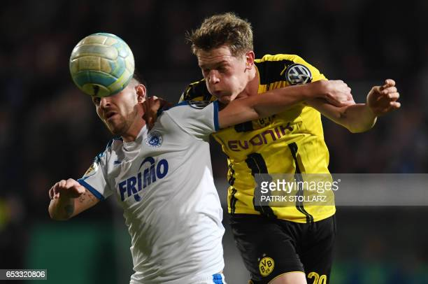 Dortmund's defender Matthias Ginter and Lotte´s Kevin Freiberger vie for the ball during the German Cup DFB Pokal quarterfinal football match...