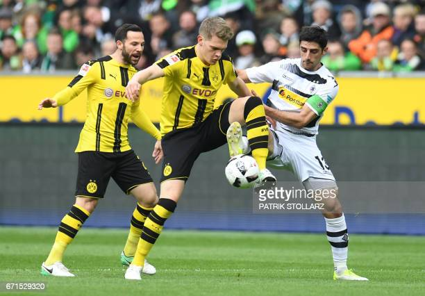 Dortmund's defender Matthias Ginter and Moenchengladbach's midfielder Lars Stindl vie for the ball during the German first division Bundesliga...