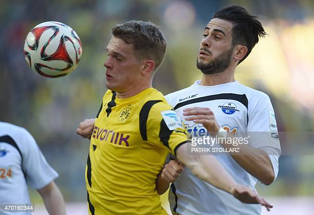 Dortmund's defender Matthias Ginter and Paderborn's midfielder Mario Vranic vie for the ball during the German first division Bundesliga football...