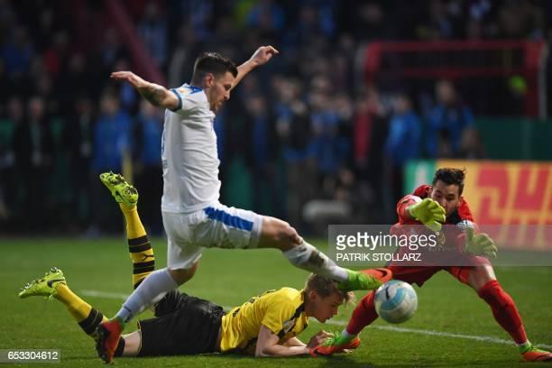 Dortmund's defender Matthias Ginter Dortmund's Swiss goalkeeper Roman Buerki and Lotte´s Bernd Rosinger vie for the ball during the German Cup DFB...