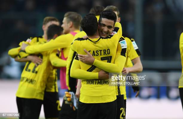 Dortmund's defender Mikel Merino and Dortmund's midfielder Gonzalo Castro react after the German first division Bundesliga football match of Borussia...