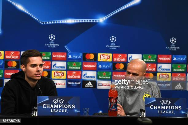 Dortmund's Dutch head coach Peter Bosz and Dortmund's midfielder Julian Weigl attend a press conference on the eve of the Champion's League Group H...
