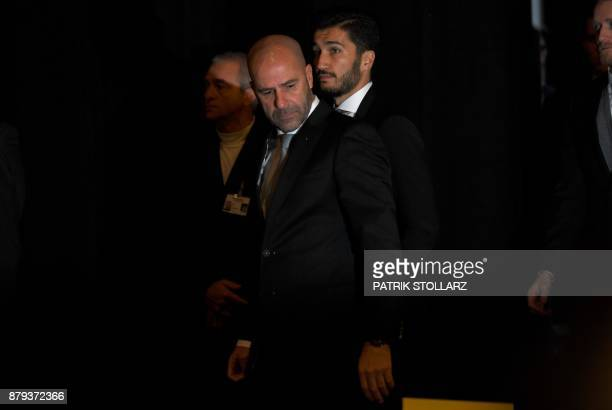 Dortmund's Dutch head coach Peter Bosz and Dortmund's midfielder Nuri Sahin arrive for the annual general meeting of German first division Bundesliga...