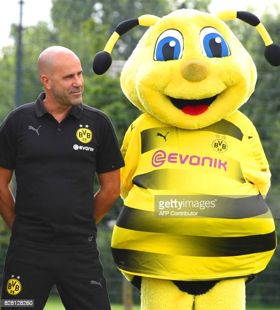 Dortmund's Dutch head coach Peter Bosz and the club's mascot Emma pose for a team photo of German first division Bundesliga football club Borussia...