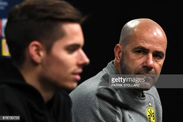 Dortmund's Dutch head coach Peter Bosz attends a press conference on the eve of the Champion's League Group H football match Borussia Dortmund...