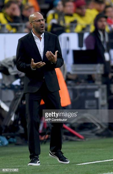 Dortmund's Dutch head coach Peter Bosz reacts during the German Supercup football match final between Borussia Dortmund vs Bayern Munich in Dortmund...