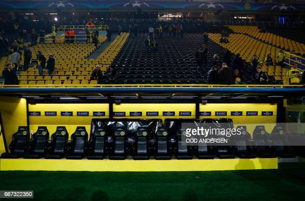 Dortmund's empty bench is seen after the team bus of Borussia Dortmund had some windows broken by an explosion some 10km away from the stadium prior...