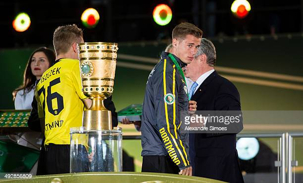 BERLIN GERMANY MAY Dortmund's Erik Durm receives his medal after the DFB Cup Final between Borussia Dortmund and Bayern Muenchen at Olympiastadion on...