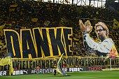 Dortmund's fans celebrate Dortmund's head coach Juergen Klopp prior to German first division Bundesliga football match between Borussia Dortmund and...