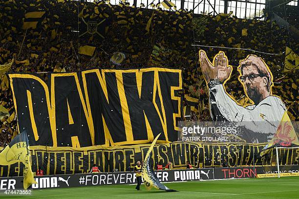 Dortmund's fans celebrate Dortmund's head coach Juergen Klopp prior to German first division Bundesliga football match between Borussia Dortmund and...