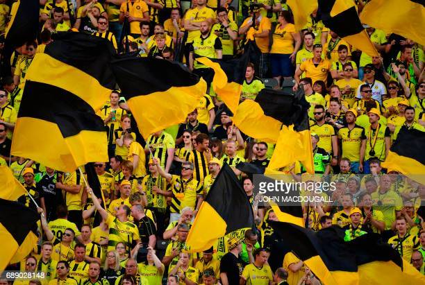 Dortmund's fans cheer ahead the German Cup final football match Eintracht Frankfurt v BVB Borussia Dortmund at the Olympic stadium in Berlin on May...