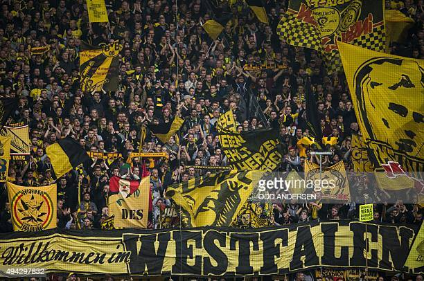Dortmund's fans cheer during the German first division football Bundesliga match between Borussia Dortmund and FC Augsburg on October 25 2015 in...