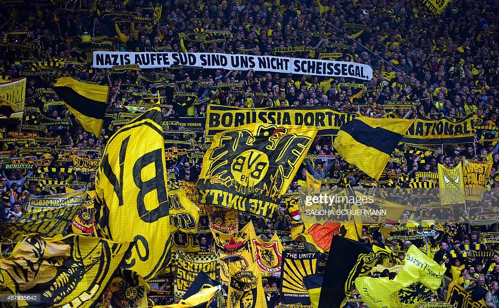 Dortmund's fans cheer their team during the German First division Bundesliga football match Borussia Dortmund vs Hannover 96 on October 25 2014 in...