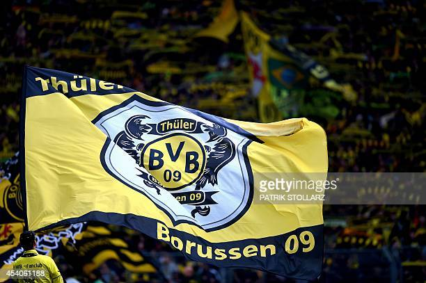 Dortmund's fans hold flags and banners during the German first division Bundesliga football match Borussia Dortmund vs Bayer Leverkusen in Dortmund...