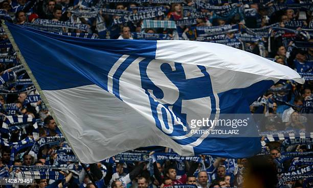 Dortmund's fans wave a flag during the German first division Bundesliga football match FC Schalke 04 vs Borussia Dortmund in the German city of...