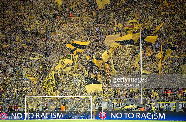 Dortmund's fans wave before the UEFA Champions League semi final first leg football match between Borussia Dortmund and Real Madrid on April 24 2013...