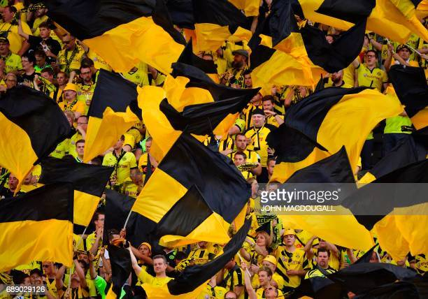 Dortmund's fans wave flags ahead the German Cup final football match Eintracht Frankfurt v BVB Borussia Dortmund at the Olympic stadium in Berlin on...