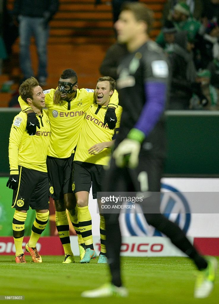 Dortmund's Felipe Santana of Brazil (C) celebrates scoring a goal with teammates during the German first division Bundesliga football match Werder Bremen vs Borussia Dortmund at the Weser stadium in Bremen on January 19, 2013.