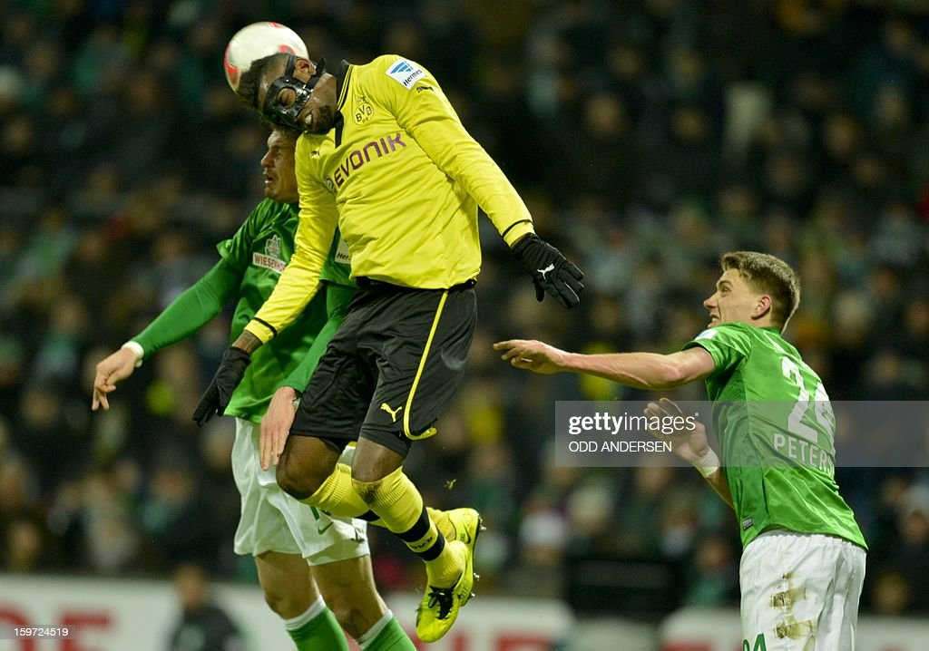Dortmund's Felipe Santana of Brazil (C) vies for the ball with Bremen's Sebastian Proedl of Austria (L) and Bremen's Nils Petersen during the German first division Bundesliga football match Werder Bremen vs Borussia Dortmund at the Weser stadium in Bremen on January 19, 2013.