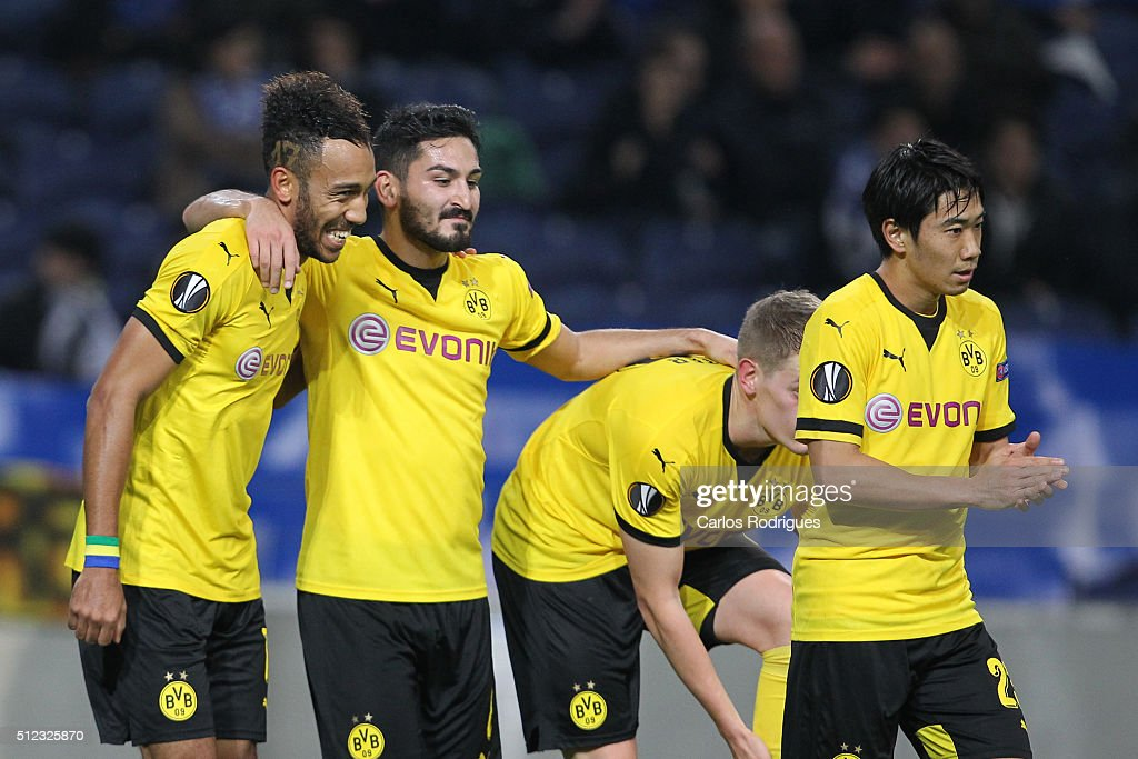 Dortmund's forward Aubameyang celebrate scoring Dortmund goal with Dortmund's midfielder Shinji Kagawa and Dortmund's midfielder Ilkay Gundogan during the Champions League match between FC Porto and Borussia Dortmund for UEFA Europa League Round of 32: Second Leg at Estadio do Dragao on February, 2016 in Porto, Portugal.