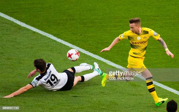 Dortmund's forward Marco Reus and Frankfurt's Argentinian defender David Abraham vie for the ball during the German Cup final football match...