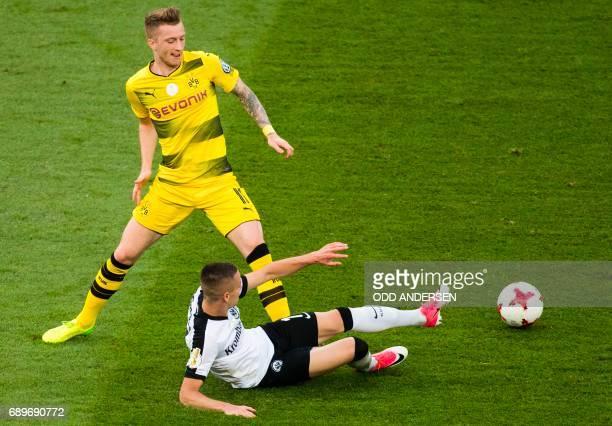 Dortmund's forward Marco Reus and Frankfurt's Serbian midfielder Mijat Gacinovic vie for the ball during the German Cup final football match...