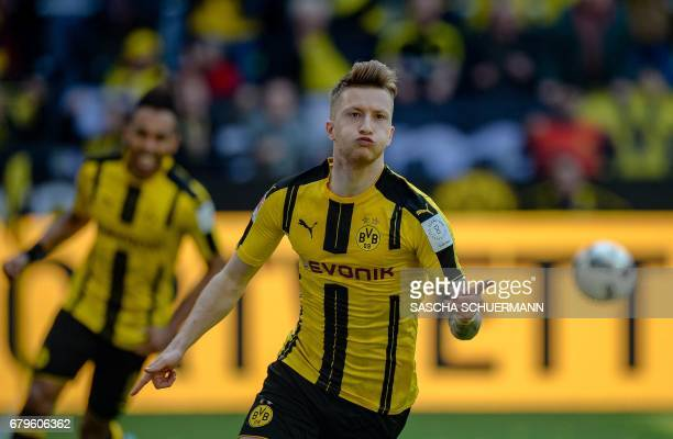 Dortmund's forward Marco Reus celebrates scoring 10 during the German first division Bundesliga football match between Borussia Dortmund and TSG 1899...