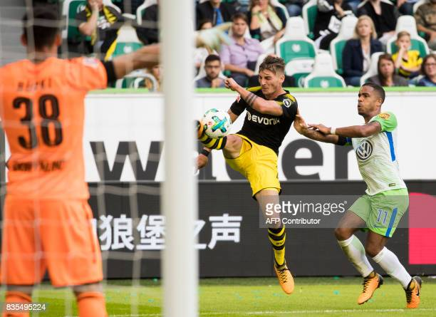 Dortmund's forward Maximilian Philipp and Wolfsburg's midfielder Daniel Didavi vie for the ball during the German First division Bundesliga football...