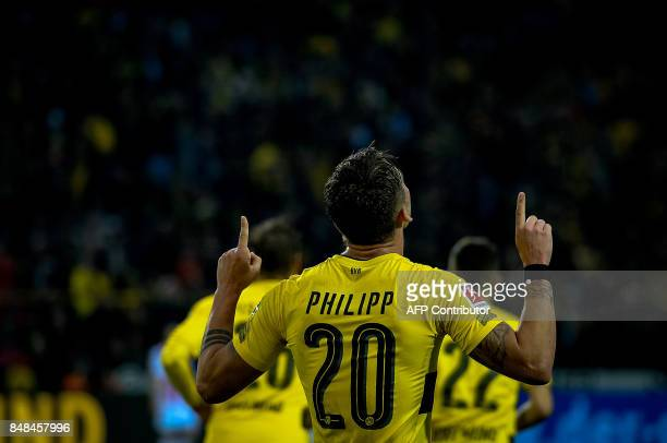 Dortmund's forward Maximilian Philipp celebrate scoring the 50 goal with his teammates during the German first division Bundesliga football match...