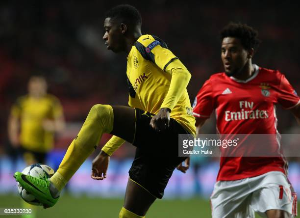 Dortmund's forward Ousmane Dembele from France with SL BenficaÕs defender Eliseu in action during the UEFA Champions League Round of 16 First Leg...