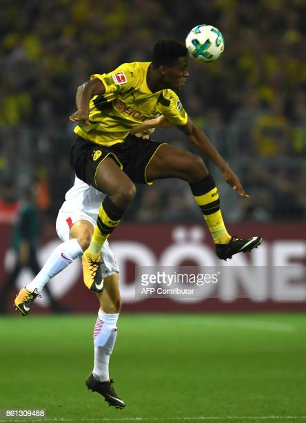 Dortmund's French defender DanAxel Zagadou and Leipzig's Austrian midfielder Konrad Laimer vie for the ball during the German first division...