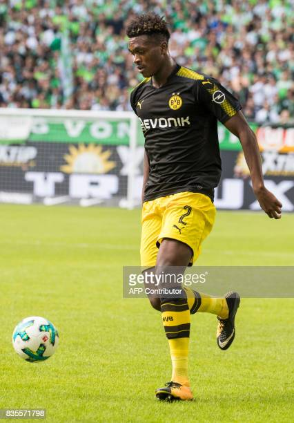 Dortmund´s French defender DanAxel Zagadou runs with the ball during the German first division Bundesliga football match Wolfsburg v Dortmund at the...