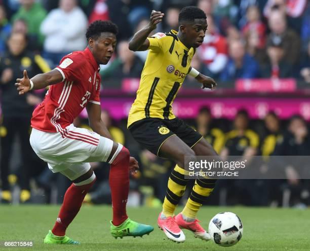 Dortmund's French midfielder Ousame Dembele and Bayern Munich's Austrian defender David Alaba vie during the German first division Bundesliga...