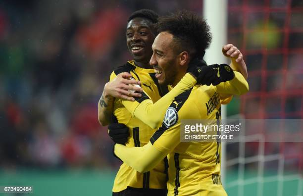 Dortmund's French midfielder Ousmane Dembele and Dortmund's Gabonese striker PierreEmerick Aubameyang celebrate after the second goal for Dortmund...