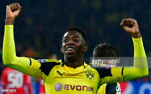 Dortmund's French midfielder Ousmane Dembele celebrates after his teammate Aubameyang scored the 30 goal during the UEFA Champions League Round of 16...